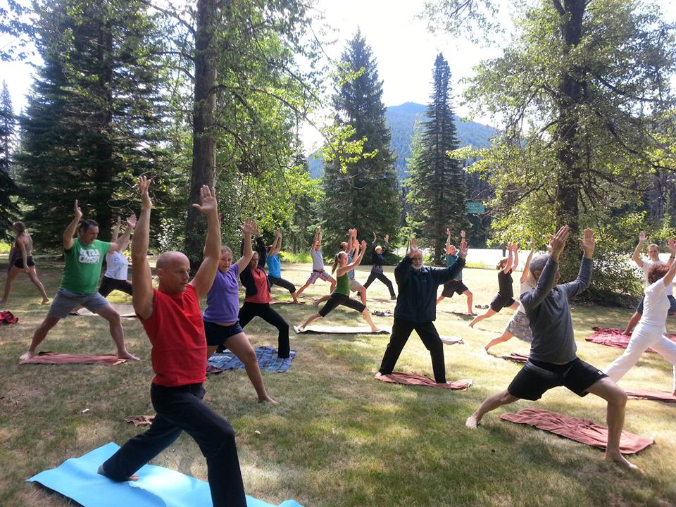 Bryce Winter leading yoga in the mountains